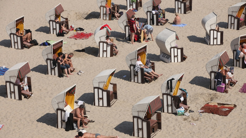 Beachgoers take in the sun at a beach on the Baltic Sea in Sellin, Germany.