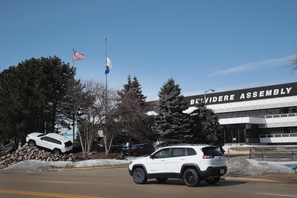 A Jeep Cherokee drives in front of Fiat Chryslers's Belvidere Assembly Plant.