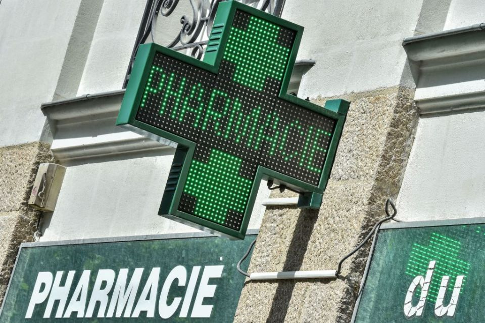 A pharmacy's green cross sign in Nantes, western France.