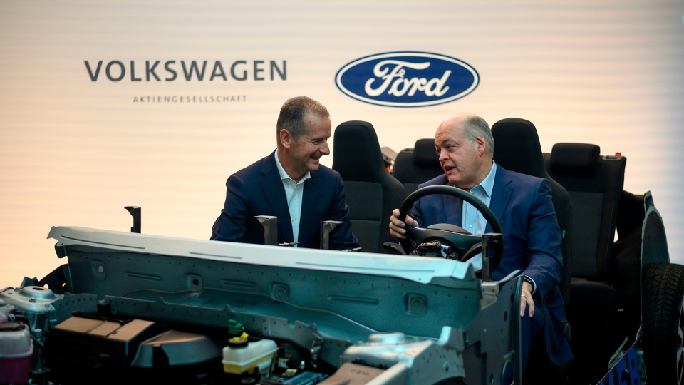 Jim Hackett (R), president and chief executive officer, Ford Motor Company, and Herbert Diess, chief executive officer, Volkswagen Group, pose for a picture ahead of a press conference July 12, 2019 in New York City.