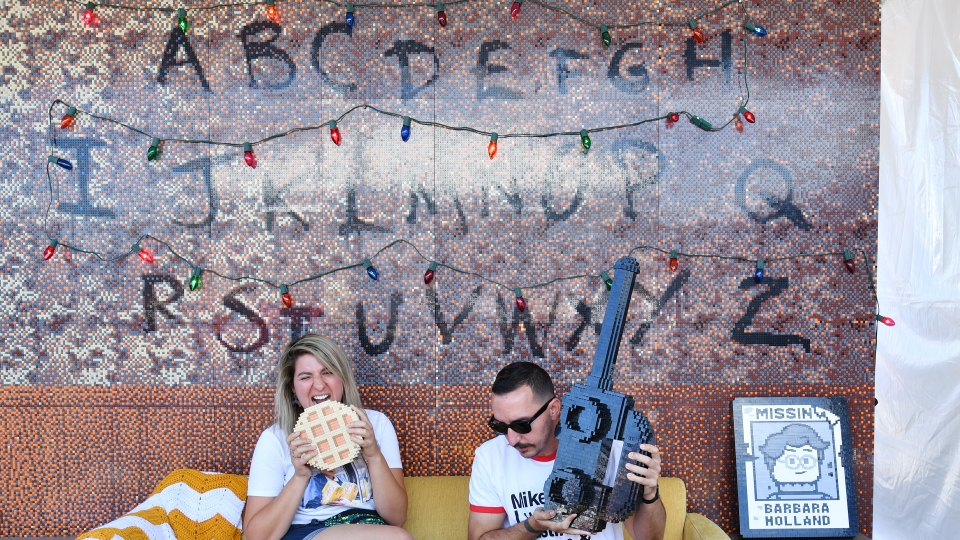 "Fans pose at the many photo-op stations at the Netflix's ""Stranger Things"" Season 3 Fun Fair at Santa Monica Pier on June 29, 2019 in Santa Monica, California."