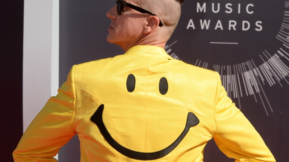Fashion designer Jeremy Scott arrives on the red carpet at the MTV Video Music Awards in 2014 at the Forum in Inglewood, California.