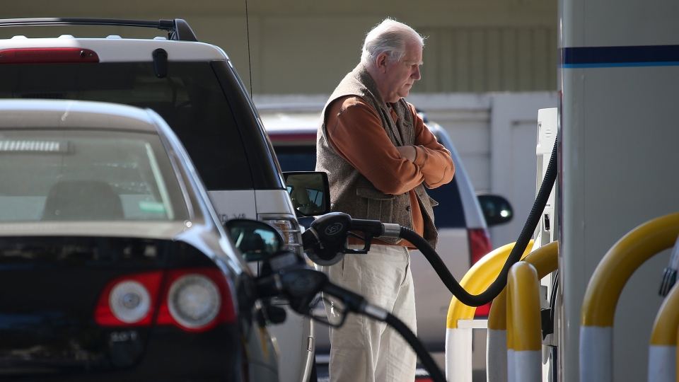 A customer pumps gas into his car at an Arco gas station in Mill Valley, California.