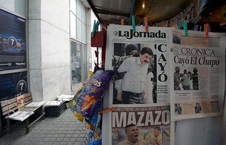 """View of the covers of Mexican newspapers in Mexico City, on February 23, 2014, after Mexican drug trafficker  Joaquín """"El Chapo"""" Guzmán was arrested."""