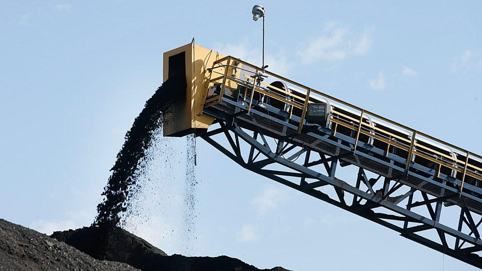 Coal falls from a conveyor belt in 2016 in Price, Utah.