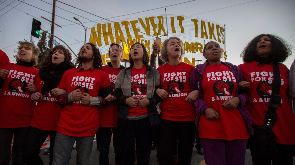 Workers strike in Los Angeles, California for a minimum wage of $15/hour in 2016.