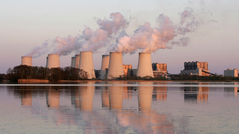 Exhaust plumes from cooling towers at a coal-fired power station in Jaenschwalde, Germany.