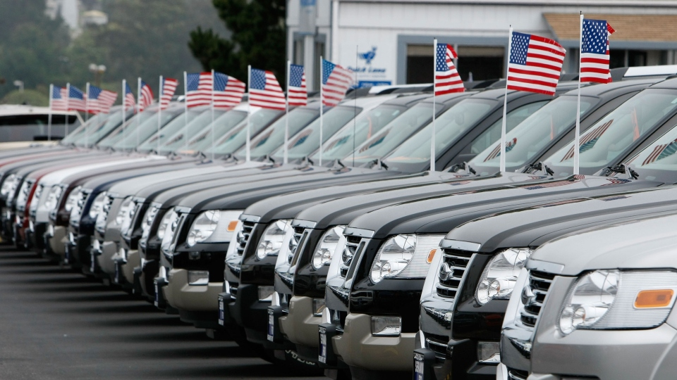 A row of new Ford trucks at a Ford dealership in Colma, California.
