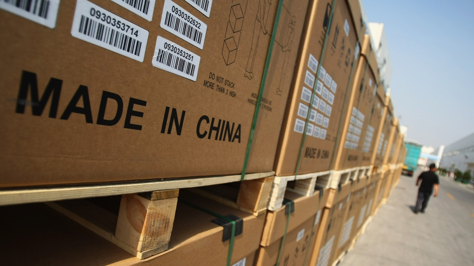 Boxes of photoelectric board products are cased at the Tianwei Yingli Green Energy Resources plant in Baoding, China.