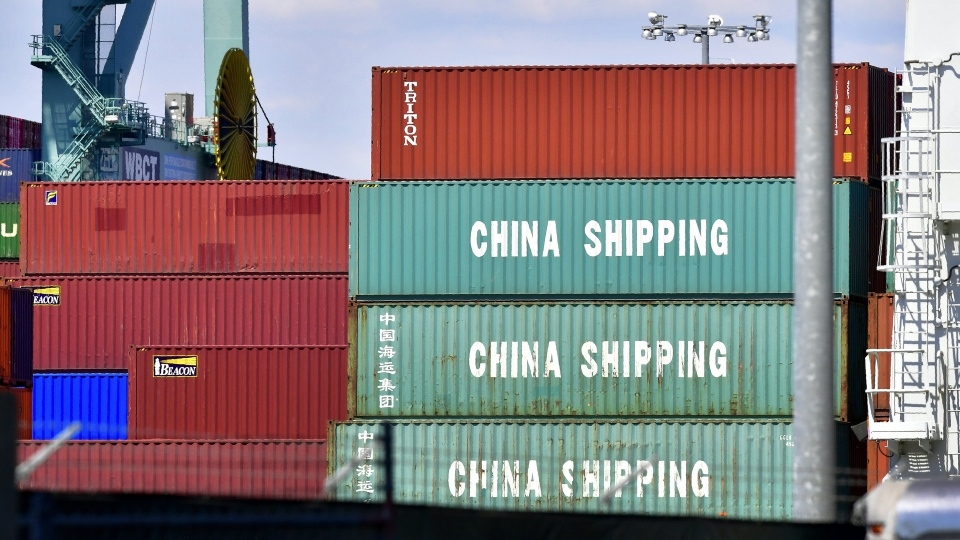 Containers are stacked on a vessel at the Port of Long Beach in California, including some from China Shipping, a conglomerate under the direct administration of China's State Council.