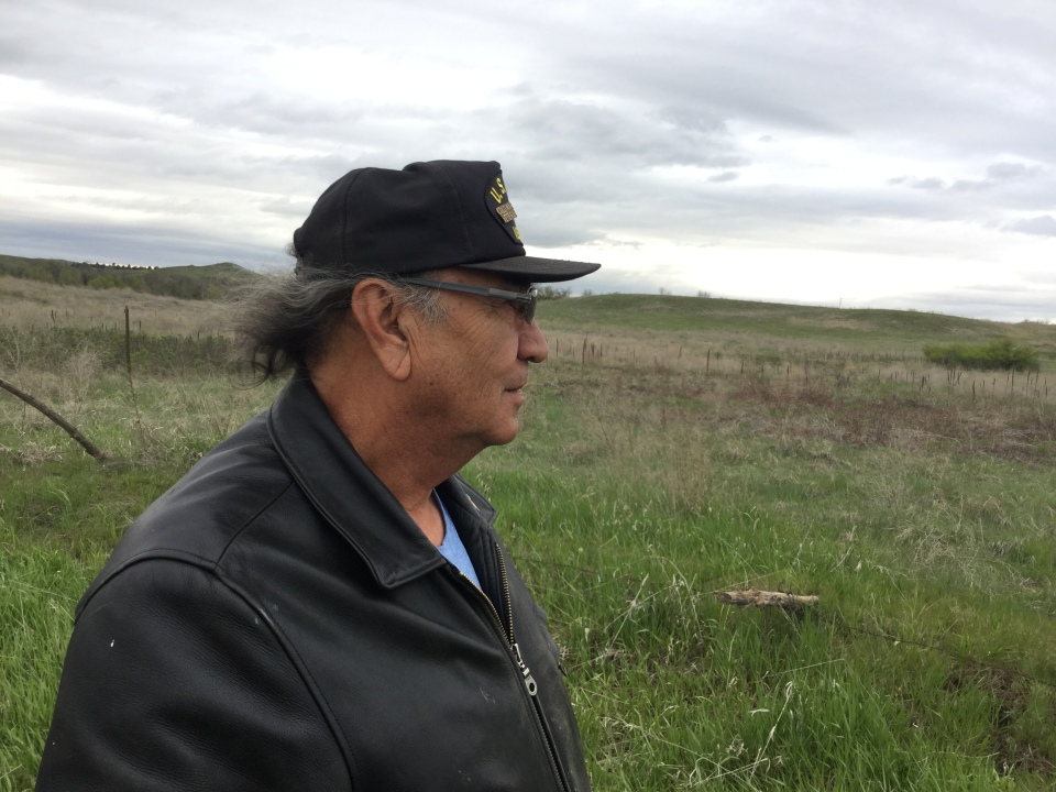Alex White Plume surveys his property on the Pine Ridge Reservation in preparation for planting his hemp crop.