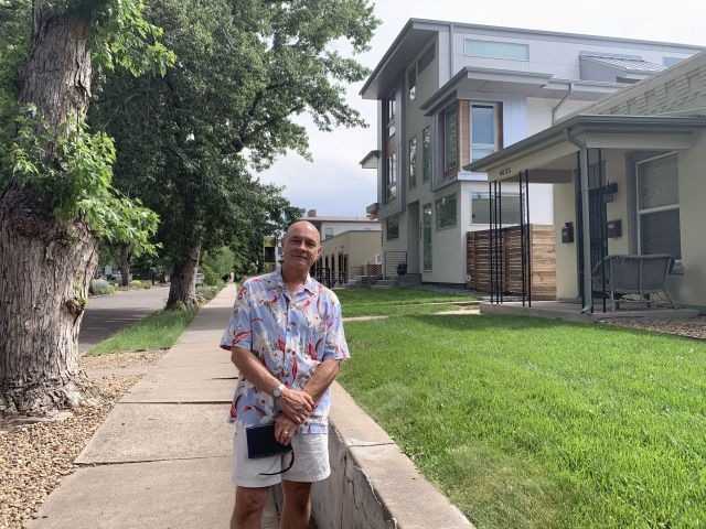 Bill Killam, a longtime resident of Denver's Berkeley neighborhood, stands on one of many blocks where large, boxy duplexes are replacing single-story homes.