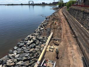 Crews rebuild a section of the Lakewalk pedestrian and bike trail in Duluth, Minn., along the shore of Lake Superior.