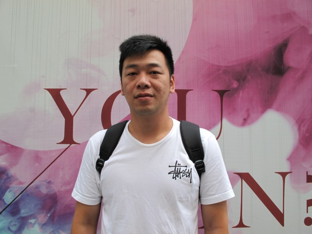 E-commerce worker, Sun Quan, suggests his recent wage increase has offset some of the  tariffs imposed on U.S. goods. Photo credit: Charles Zhang/Marketplace