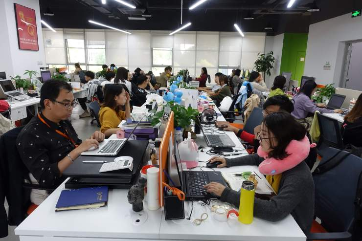E-commerce firm Baiqiu's has more than 1,000 staff all asked to sort their own waste. Credit: Charles Zhang/Marketplace