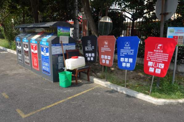 A jug of water is set next to a garbage sorting station for residents to clean up after people complained that the sorting process made their hands dirty. Credit: Charles Zhang/Marketplace