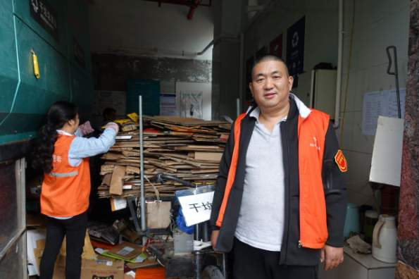 Huang Youjun said he is putting in more hours at this garbage transfer station. He needs to ensure the waste is sorted correctly or else the garbage trucks can refuse to transport it. Credit: Charles Zhang/Marketplace