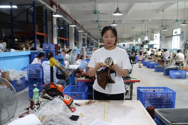 The salary that Li Xiaolin earns goes towards her son's private school fees . She  doesn't want her child n to work in factories (Photo credit: Charles Zhang/Marketplace)