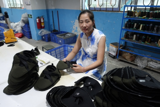 Li Zhaomin sends half of her salary home to her parents because the pension in the countryside is marginal. (Charles Zhang/Marketplace)