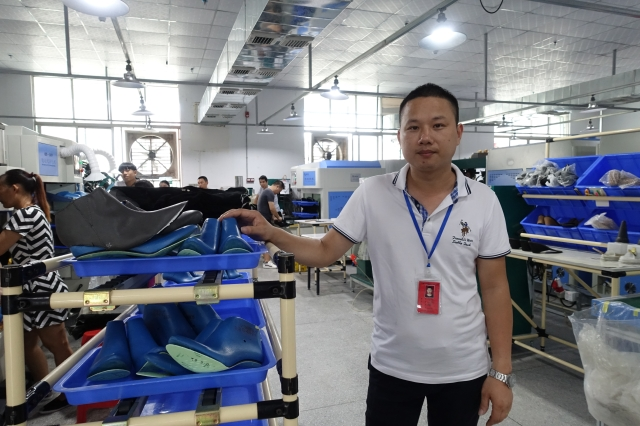 Factory worker Liu Ping says it is normal to work 14-hour days in the shoe industry. (Photo credit: Charles Zhang/Marketplace)
