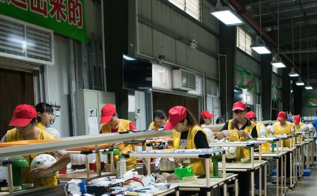 Shuoke's soccer ball assembly line. The firm has tripled production without hiring many more staff. (Shanghai 808 Studio)