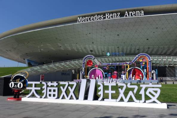 """Alibaba's Tmall display advertising the Singles Day or """"Double 11th"""" sales event in front of an events arena in Shanghai. (Charles Zhang/Marketplace)"""