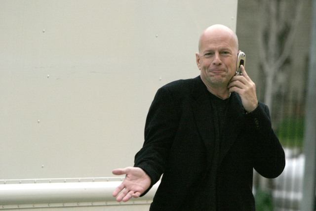 A photo of actor Bruce Willis on the phone in the 2000s.
