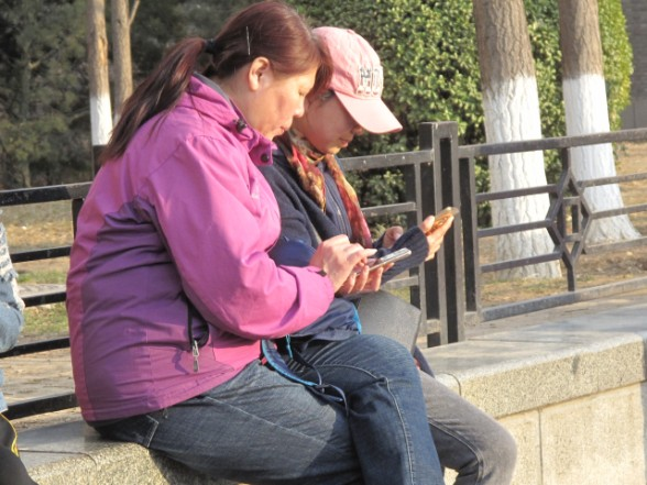Smartphones are now an essential tool for daily living in China. (Credit: Jennifer Pak/Marketplace)