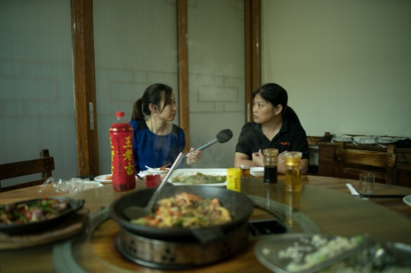 Li Guilian speaks to Marketplace over lunch since it was hard for her to request for time off at her new factory job. Li said it is harder to find good factory jobs in China. (Credit: Shanghai 808 Studio)