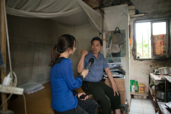 Li Xiangjun lives in a tiny room to keep expenses low. He is saving for medical emergencies because people in China can still go bankrupt from a major illness. (Credit: Shanghai 808 Studio)