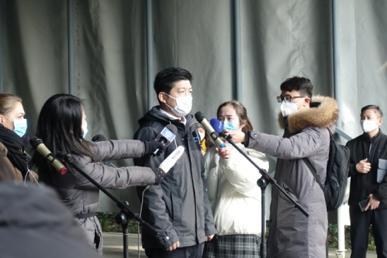 Li Jia, a division chief at the city's manufacturing industries watchdog, the Shanghai Commission of Economy and Information Technology, assures the media that the city is addressing the shortage of face masks. (Credit: Jennifer Pak/Marketplace)