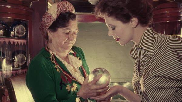 A fortune-teller predicts the future using a crystal ball.