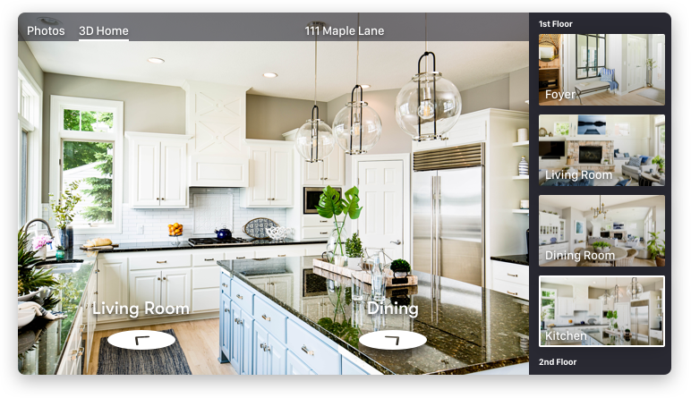 A screenshot of Zillow's virtual house tour, picturing a kitchen and dining area, the foyer and a living room.
