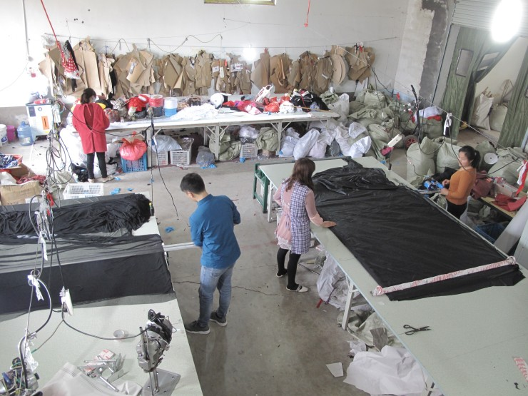 Workers cutting fabric on the factory floor of Midnight Charm lingerie factory in a rural farming community. Half of the products they make end up in the U.S. (Charles Zhang/Marketplace)