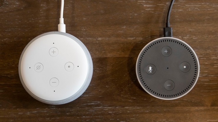 """An updated """"Echo Dot"""" (left) is pictured next to an older generation """"Echo Dot"""" at Amazon Headquarters, on Sep. 20, 2018, in Seattle Washington."""