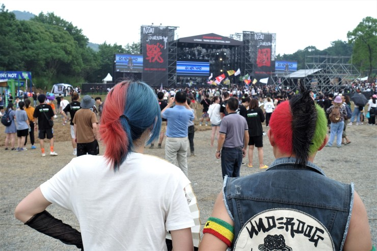 Chinese music lovers look on during a metal band performance at the MIDI festival in June. Music festivals are seen as economic boosters for host cities. (Charles Zhang/Marketplace)
