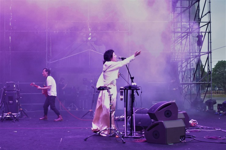 Punk band Subs performs at the MIDI festival in June. Singer Kang Mao (center) and guitarist Wu Hao (left) mostly write songs in English because they were influenced by western rock music. (Charles Zhang/Marketplace)