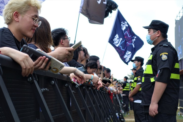 Heavy presence of security and police at the MIDI music festival for crowd safety but also to ensure there are no political statements made. (Charles Zhang/Marketplace)