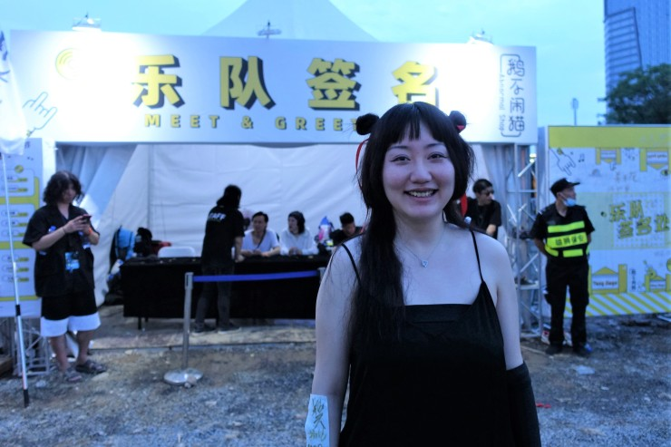 A fan of punk band Subs, Zheng Ying, said she regularly buys CDs and attends live music performances. The band said young fans like her tend to spend less on music as they get older. (Charles Zhang/Marketplace)
