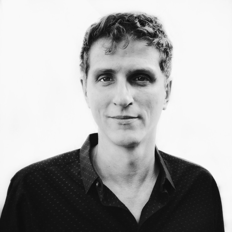 Jeff Horwitz, in black and white, poses for his headshot wearing a dark collared shirt.