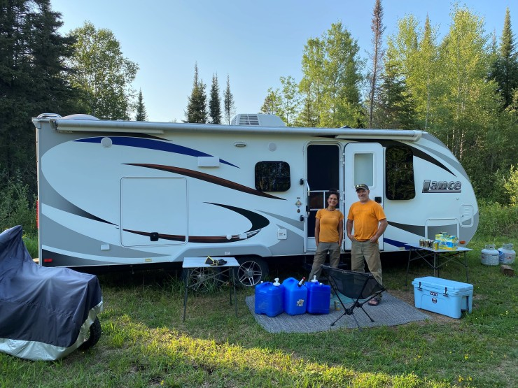 Adam and Mica Harju of Grand Marais sleep in this camper for weeks at a time when they travel around the country to build mountain bike trails Theyre pictured here in Lake County on Aug 9 where they were building a new trail in the Split Rock Wilds trail system